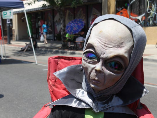 Festival-goers enjoy Thursday's UFO Festival in Roswell.