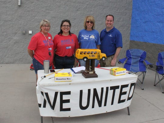 United Way and Boy and Girls Club volunteers collect
