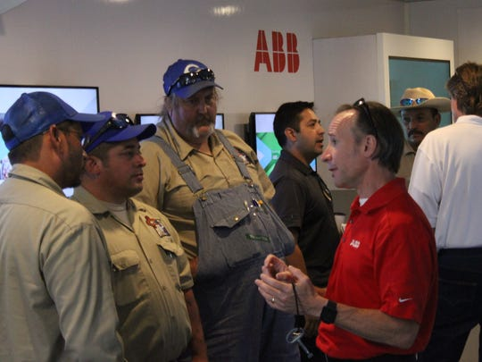 Local workers tour some of the latest drive motor technology created by tech company ABB, Wednesday at the Pecos River Village Conference Center.