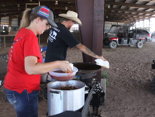 Contestants prepare their chili ahead of judging for