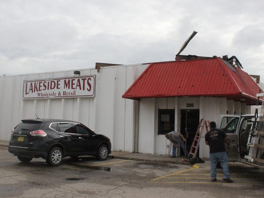 The roof of Lakeside Meats, where the iconic cow statue stood for decades, sits empty after a fire destroyed the statue, Tuesday at 206 S. Main St.