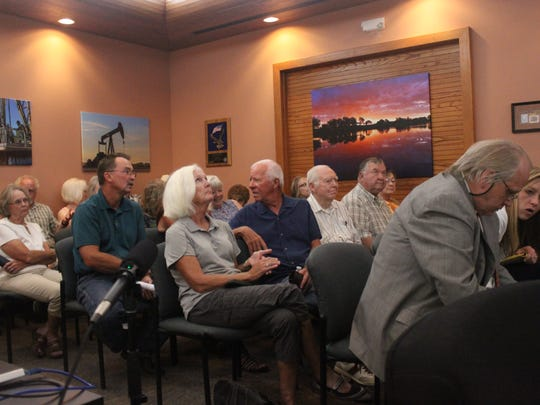 Eddy County residents address the Planning and Development Committee during a public hearing on an ordinance intended to regulate man camps, which house transient oil workers, Aug. 17 at the Eddy County Administration Building.
