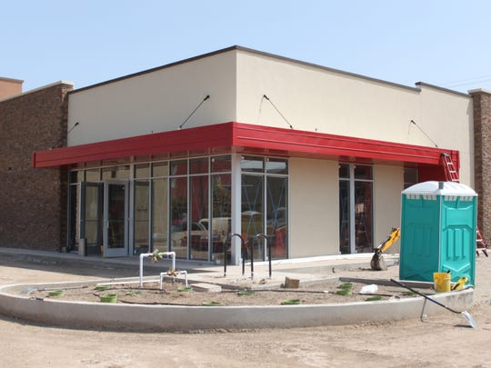 The future location of a new Domino's Pizza is being built, Aug. 31 at the corner of South Canal and Greene streets.
