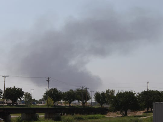 A cloud of smoke rises above the city after a reported battery tank explosion, Sept. 1 in Carlsbad.