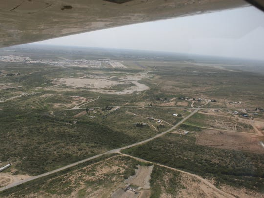 The view over southern Eddy County from a six-seat plane as local leaders view landmarks and assess the impact of the oil and gas industry, Sept. 6 at the Cavern City Air Terminal.
