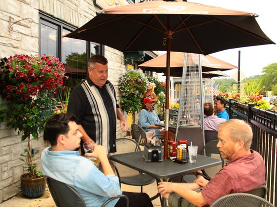 Jaime O'Donoghue (standing) greets guests at his pub located at 13225 Watertown Plank Rd, in Elm Grove, WI.