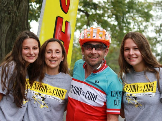 Century for the Cure founder Scott Glickman poses with wife Aileen and their daughters Emily (left) and Julia (right) at the finish line of last year's event.