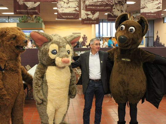 Carlsbad Mayor Dale Janway poses with three National Park Service mascots, Sept. 30 at Living Desert Zoo and Gardens State Park.