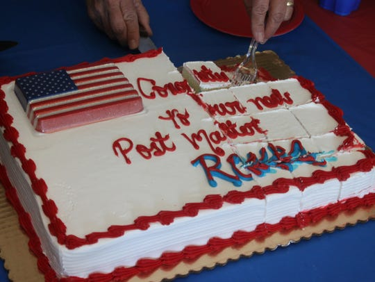 Post office employees were served a cake to commemorate