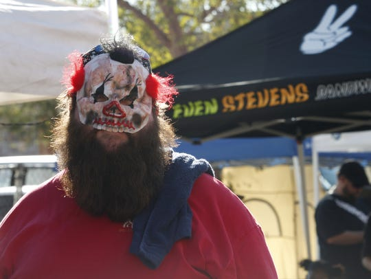 Paul Duddy shows off his mask at the Zombie Walk in