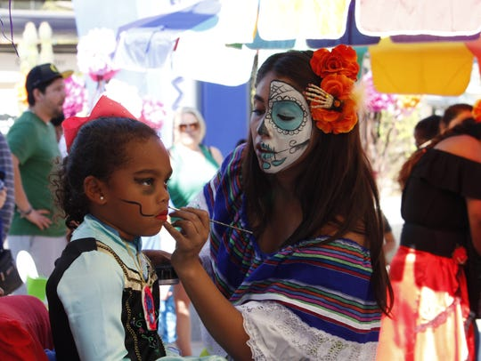 Five-year-old Maliyah Henderson gets her face painted