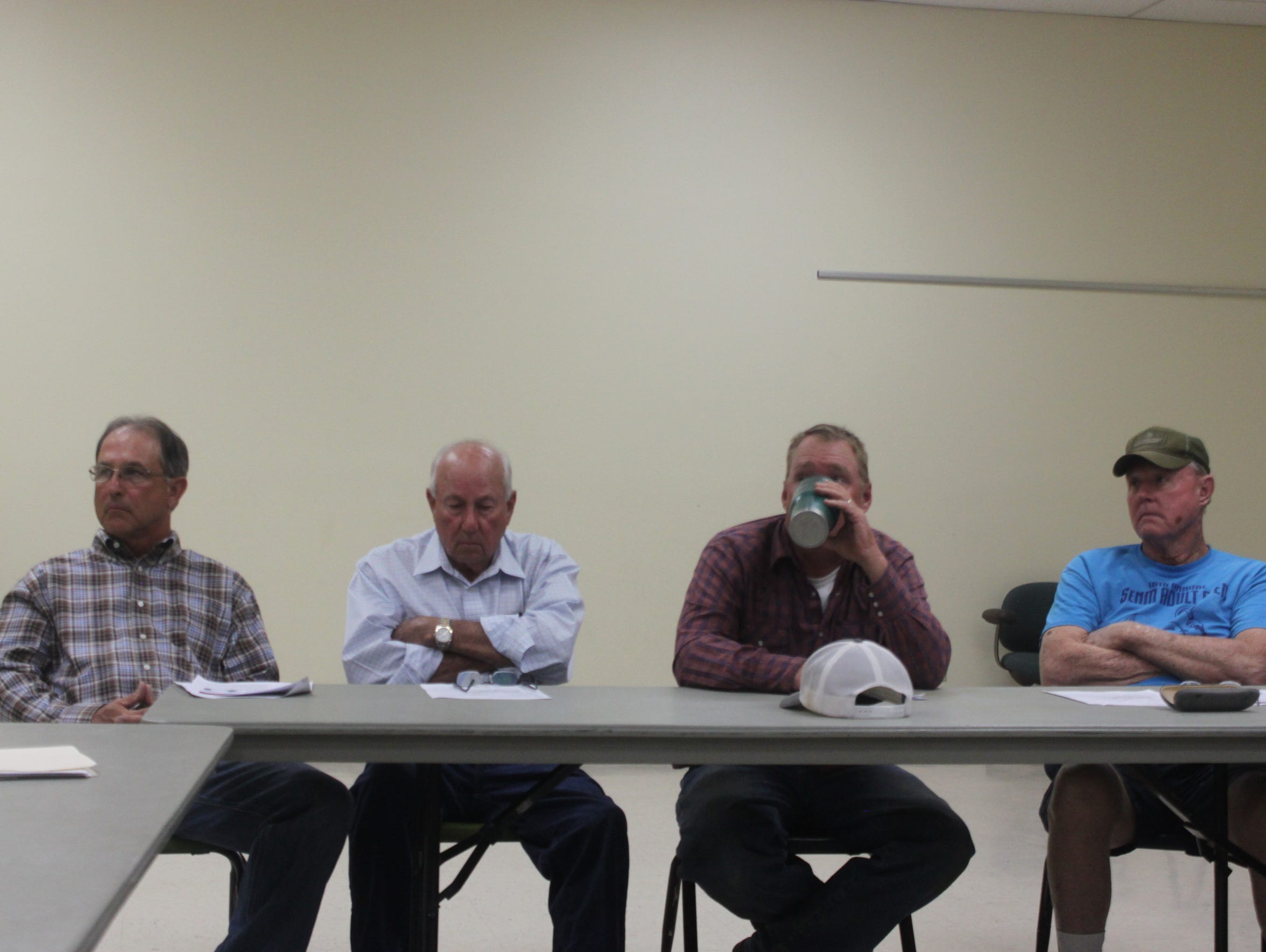 A group of pecan growers and sellers listen to presentation