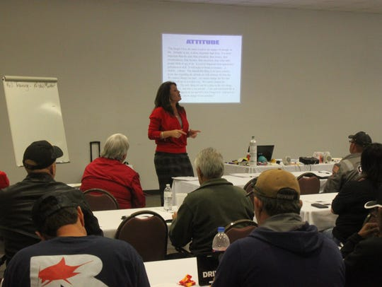 Krisha Marker lectures a group of industrial workers