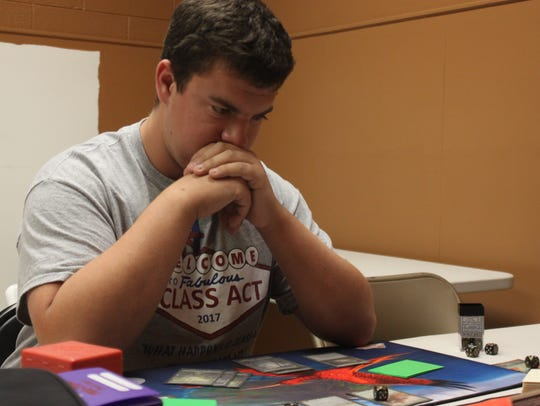 A player contimplates his next move during a Magic