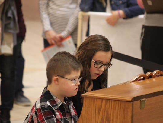 Playing a Christmas duet at center court of the Forest