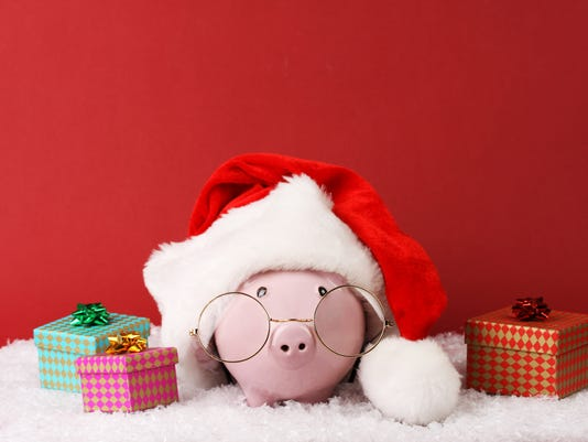 Black piggy box with text Xmas standing on fur