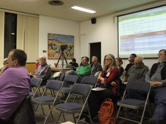 Attendees listen to a presentation on the Waste Isolation Pilot Plant during a town hall meeting, Dec. 6 at the Carlsbad Municipal Building.