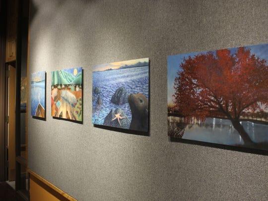 Oil paintings by local teacher Lisa Caplis are on display,