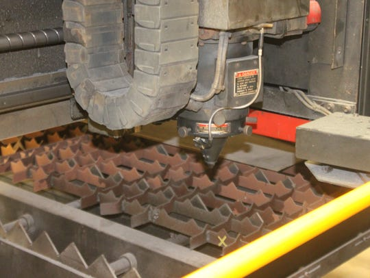 A 3,000-watt laser beam is used to cut metal and other