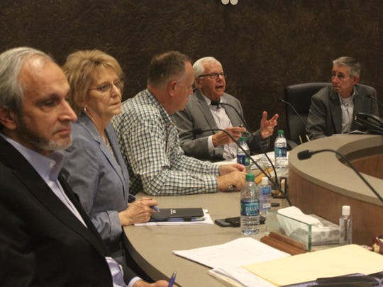 Members of the Carlsbad Brine Well Remediation Advisory Authority discuss funding for the project during a meeting, Jan. 10 at the Municipal Annex Building.