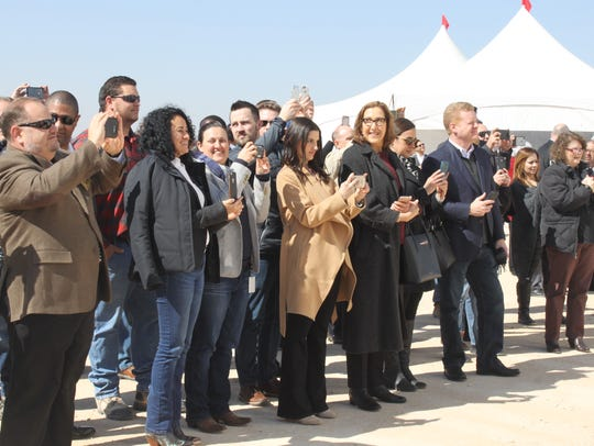 Local leaders, residents and industry officials meet