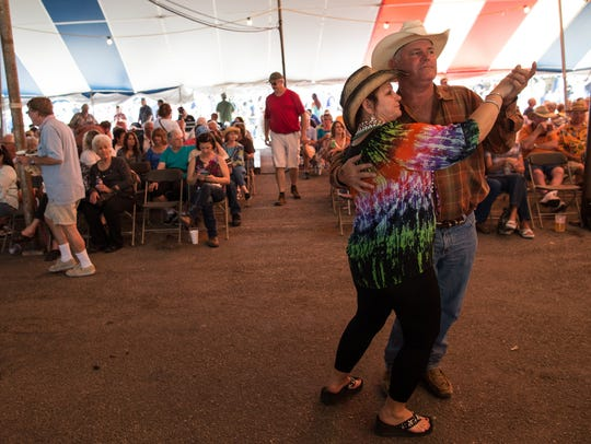 Joyce and Kelly Sbrusch of Edna Texas dance during