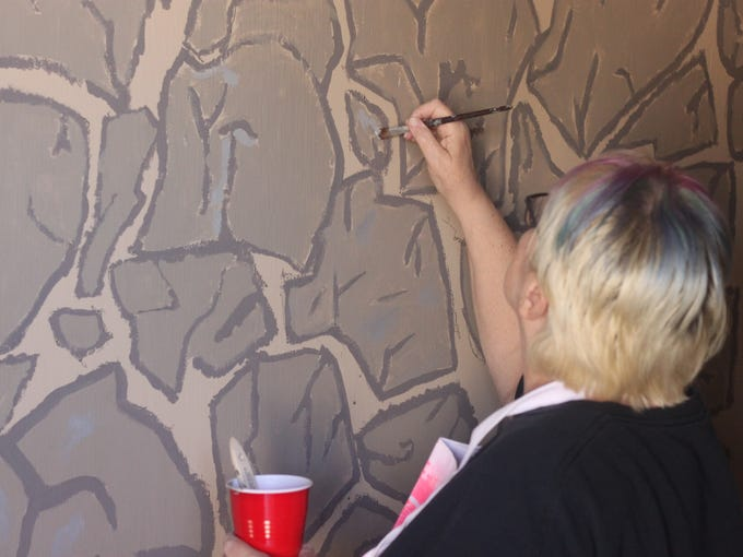 Carlsbad students and faculty paint a mural on the