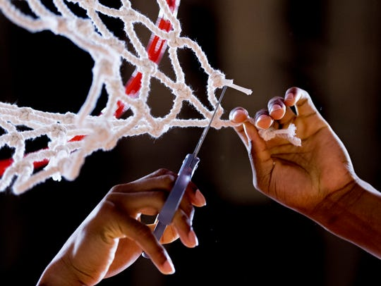 A Tennessee player cuts down a piece of the net during