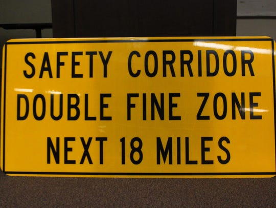 A sign used to alert motorists of the safety corridor