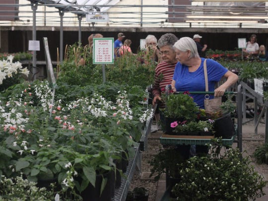 CARC residents, and volunteers were on-hand for the CARC greenhouse and store's spring opening, where residents can shop for myriad flowers and plants, March 24, 2018, at 902 W. Cherry Lane.