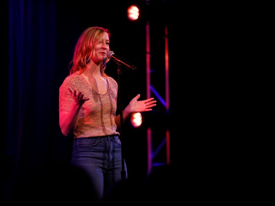 "Elle Wignall tells her story Thursday, April 5, 2018, during the Des Moines Storytellers Project's show called ""Busted: Stories of When I Got Caught"" at the Temple Theater in Des Moines."