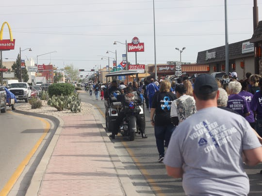 Hundreds of Carlsbad residents, school children and local leaders march for the annual Walk Against Child Abuse, April 6, 2018 at the New Mexico Children, Youth, and Families Department.
