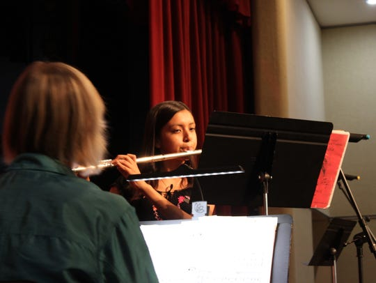 Yamalet Herrera performs a piece on the flute for the