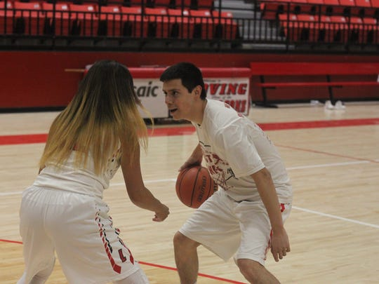 Steve Carrasco (right) plays a game of one on one with his sister Alyssa Carrasco, May 4, 2018 at the Loving High School Gym.