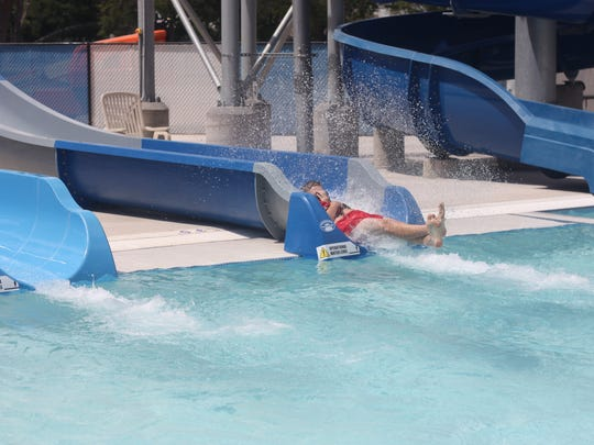 Children from Carlsbad and the surrounding areas cool down in the pools and slides of the Carlsbad Water Park, during the grand opening, May 26, 2018 on Park Drive.
