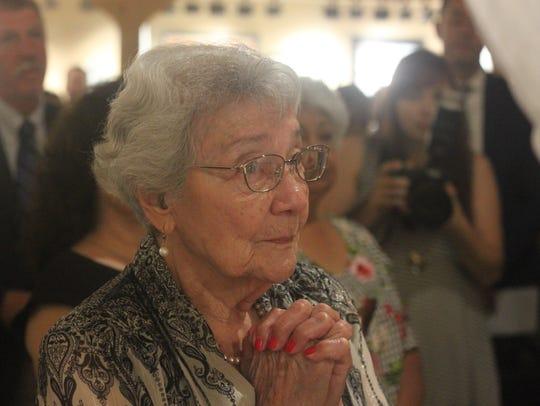 Virginia Leyva, wife of P.R. Leyva, attends a flag