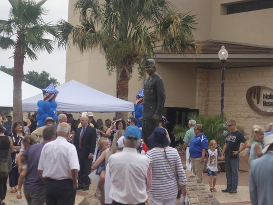 A statue sporting the likeness of Fred Mahaffey is unveiled during a ceremony, July 7, 2018 in Carlsbad.