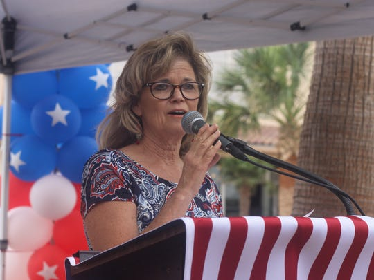 Julie Augeri, daughter of the late Fred Mahaffey, speaks about her father during a ceremony in his honor, July 7, 2018 in Carlsbad.