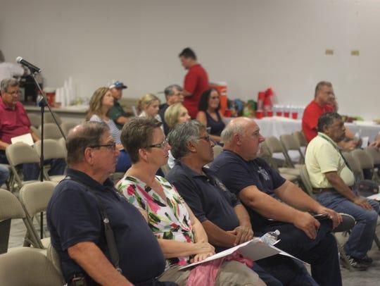 Members of the Otis Volunteer Fire Service look on