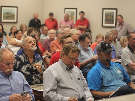 Carlsbad residents and local leaders attend a meeting
