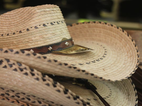 Straw hats are one of many popular items sold during the grand opening of Bennie's Western Wear, July 21, 2018 in Carlsbad.