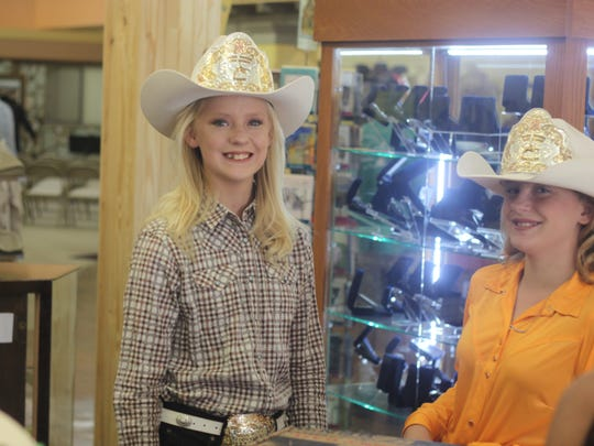 Rodeo princesses from the Eddy County Sheriff's Posse help out during the grand opening of Bennie's Western Wear, July 21, 2018 in Carlsbad.