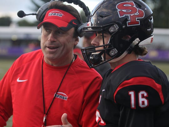 SPASH football coach Pete McAdams talks over strategy