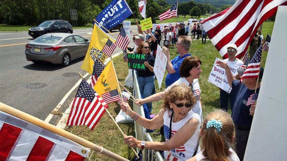 Protesters greeted golf fans headed toward a remote parking lot for the U.S. Women's Open at Trump National Bedminster Golf Club.