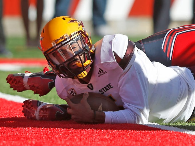 Arizona State quarterback Manny Wilkins (5) scores