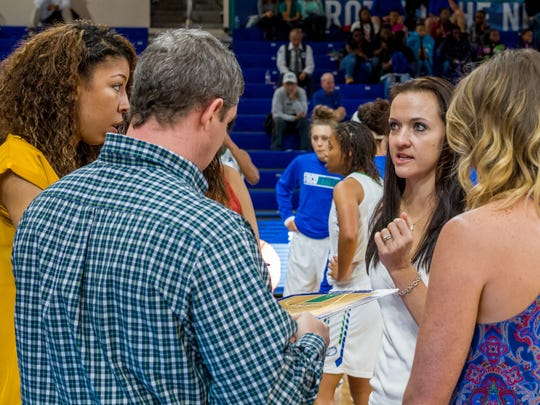 Because they all played for him, FGCU coach Karl Smesko assistants Chelsea Lyles (far left), Chelsea Banbury (third from left) and Jenna Cobb (right) know exactly what their head coach wants.