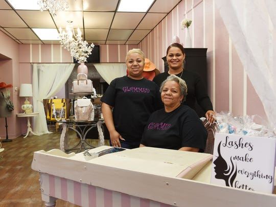 Morgan Jones, left, and Whitney Gibson, seen with their mentor Beverly Jones, run Glammed on Main Street in Zanesville.