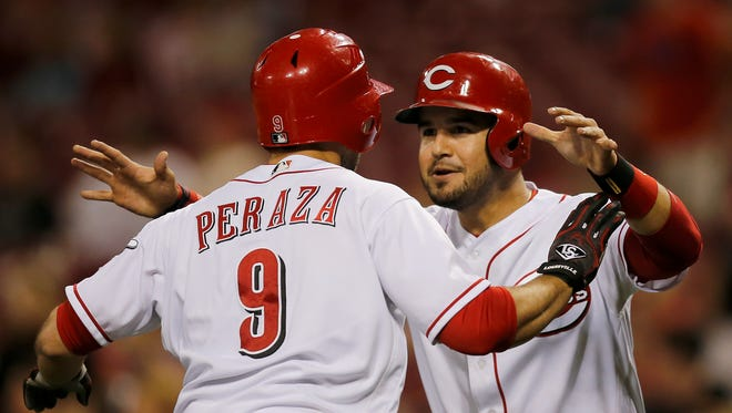 Cincinnati Reds second baseman Jose Peraza (9) and third baseman Eugenio Suarez (7) celebrate Peraza's two-run home run in the bottom of the eighth inning against the Colorado Rockies on on Friday, May 19, 2017.