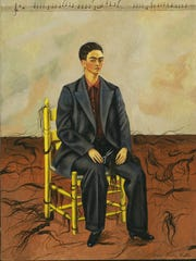 """Frida Kahlo's """"Self-Portrait with Cropped Hair,"""" an oil on canvas, was painted in 1940."""