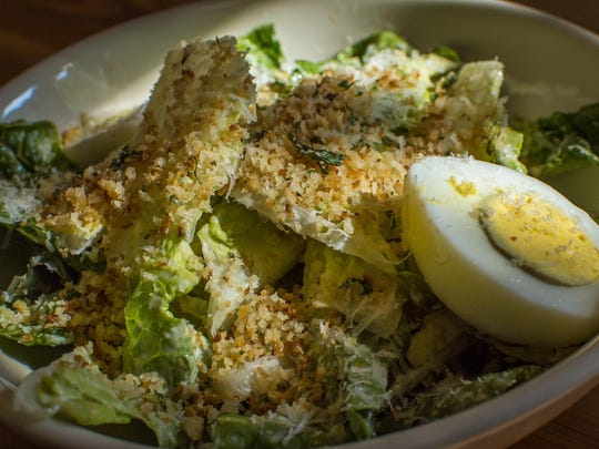 The Doc Caesar with gem lettuce, herbed crumb, chopped egg and dry jack cheese at Doc Ponds in Stowe on Monday.